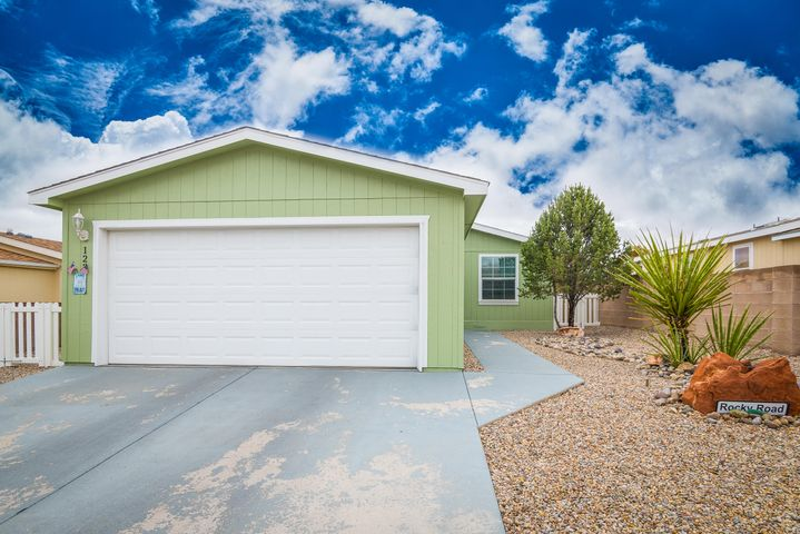 Beautiful Home in Sunrise Bluffs 55+ Community in Belen!  This home is 1271SF with 2BR's, 2BA's and 2CG.  REFRIGERATED Air! Owner had the entire home painted in 10/2018, a new water heater installed on 11/11/18. Nicely updated ceiling fans in All rooms. Kitchen has granite countertops and plenty of cabinet space! There is a security door, exterior tool/garden shed and spacious covered patio. The Master Bedroom is very spacious and has a nice walk in closet. The community has a clubhouse which includes an indoor heated pool, exercise room, daily activities.  There is an onsite RV parking for residents for a small monthly fee. You will love living here!!
