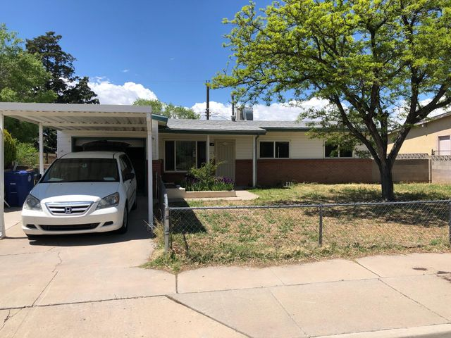 Special features include open light floor plan, large country kitchen, new water heater  flooring (ceramic tile & Pergo), extra large attached one-car garage and Lots of cabinets and storage throughout.