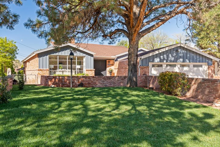 Come and see this gorgeous brick mid-Century home that has been beautifully renovated with a fabulous modern flare. Located in the UNM area, this home is located by Altura Park, Downtown, and the Uptown shopping district.  This home features new carpet, new tile, terrazzo tile, and Mossman wood flooring throughout. Fully updated refrigerated air and central forced heat. Fantastic updated kitchen with high-end stainless steel appliances, quartz countertops, and new cabinets. Bathrooms are luxurious and host quartz countertops, tiled showers, and new cabinets. The new lighting fixtures throughout the home will wow you! The master suite is spacious and cozy. The fantastic walkout multi-functional completely finished basement is over 1,000 square feet and includes a spacious bedroom.