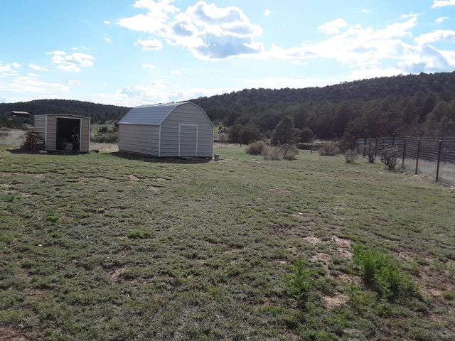 Well kept home in a great area. Some upgrades are in progress painting, skirting and flooring. Almost 4 acres of mountain living. Bring all reasonable offers while painting and updates are being made.