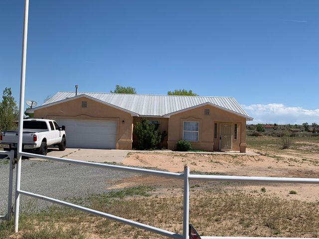 This homes sits on 1.3 acres with views all around. Bring the horses or animals and family to enjoy the Large living room with open floorplan that flows, large master suite with 2 walk in closets and the ambiance of the country and quietness. Recently painted the entire house on the inside, new flooring, new light fixtures, put 2 new toilets, blinds,  new hot water heater, new kitchen sink, new bathroom faucets, new shower heads, put all new bedroom doors & of course knobs. This home has so many possibilities and ready for a new family.