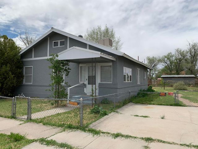 This home sits on 2 large lots with back yard access.  Fresh Paint, refinished wood floors, new cabinets and counter tops, new carpet, and some new windows.  Newer Metal roof. Electrical redone also. This home has so much character.  The family room with real wood floors. This home has one of the largest lots inthe area.  Dont wait as this one wont last long. This home use to be a local doctors home back in the 1930's and 40's