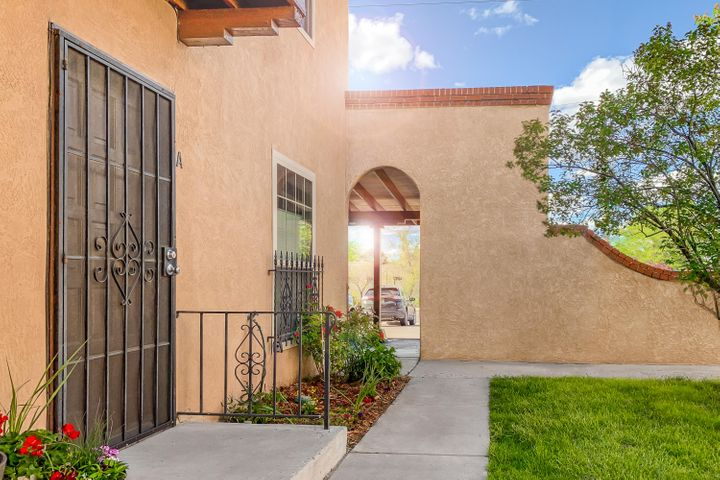 This bright and airy UNM area townhouse in the popular Indian School Townhouse community is turn-key ready.  Convenient to many amenities, this is a great location.  The kitchen has been freshly updated, and this unit has newer vinyl windows, and refrigerated air.  This is the largest unit in the community, with an additional first floor living space that you won't find in the other units. The yard is private and set up for entertainment and gardening, with a side entrance gate from the parking lot. There is also a 300+ sqft bonus space that can be used for a workshop or just about anything else, and is attached to the unit, accessible by an exterior door in the back yard, and NOT included in the square footage. Take a look for yourself, this is a really cute charmer!