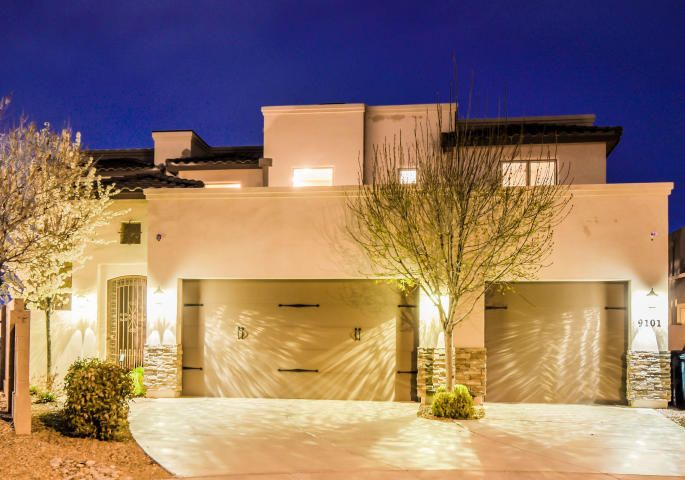 Stunning Tim Helmick custom home located in the popular Desert Ridge Trails community of Albuquerque Acres! Home features 3,947sf with 5 bedrooms, 3 bathrooms, & a 3 car garage! Home exudes a luxurious feel from the moment you enter. Beautiful living area with coffered ceilings and a custom gas fireplace & hearth. Gourmet kitchen fit for a chef with custom cabinetry & crown molding, granite countertops, built-in double oven, commercial grade gas cooktop, range, backsplash, center prep island w/ sink, a pantry, large bar with seating area and a built-in desk/work area. Separate dining area. First floor master suite w/ an exquisite ensuite featuring his/her sinks, a large soaking tub, walk-in shower w/ bench, a private sauna & massive walk-in closet! Great yard with covered patio & privacy!