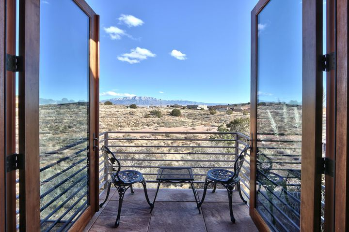 Spectacular custom home w/ panoramic unobstructed mountain views that perfectly integrates the natural world w/ luxurious, top-of-the-line interior features. Flooded w/ New Mexico's stunningly beautiful light, architect Bob Clark brings the outside into interior living spaces w/ meticulous attention to detail & quality including tile & leather floors, hand-carved solid wood doors, jade tile & signature chandeliers. Gourmet kitchen features Wolf SS appliances, walnut cabinetry, tons of storage, & spacious pantry. Sunset courtyard has gorgeous mosaic mural & zen-like garden greets visitors as they approach the leaded glass front door. The perfect setting for entertaining w/ outside portals, fire pit & seating area w/ gas barbecue.  New Mexico living at its very finest, minutes from amenities