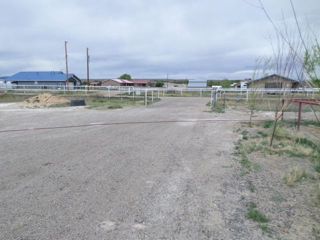 A true mini ranch with complete horse and roping facilities and pipe fencing all around.  Sitting on 2 acres of prime land in Belen this one of a kind property sits close to the Sheriff's Posse Arena & Wal Mart. She comes with horse facility's, stalls, roping arena, turn outs, returns, stripping chutes & catch pens for the beginner or the seasoned professional.   The property has it's its own well, septic tank, natural gas and electrical.  It's a 3-bedroom, 2 baths with a rocking chair porch to enjoy evening coffee and to watch those beautiful New Mexico sunsets with your loved ones.  Conveniently located to shopping and freeway access.  This home has lots of potential come see it today.
