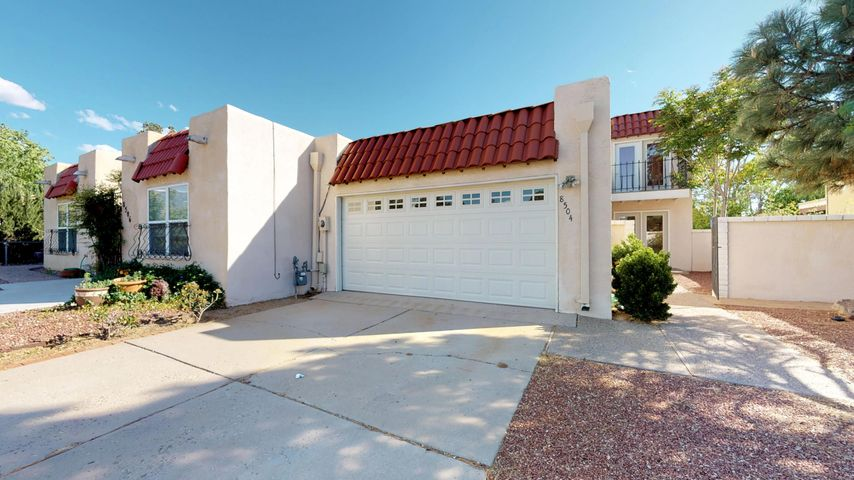 **Price Reduced** 2100 sqft 3 bd 3bth townhome, no living area shared walls. New exterior doors, custom made cabinets in this open kitchen. Amazing views of the Sandia mountains from the master balcony. Refrigerated air. Newer windows, back yard access with a fully landscaped yard. Prelisting inspection with completed repairs. Minor updates to continue while active.