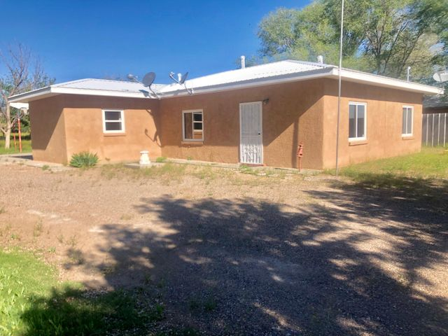 Great home with land and many possibilities! This home sits on almost 1.5 acres, has a main home with 2 bedrooms possible, a bath room, and laundry area. The second building also has its own bathroom and laundry area and 1 car garage! Very close to 1-25 for travel to surrounding areas, newer updates throughout including roof and refrigerated air! Call today to schedule a showing!