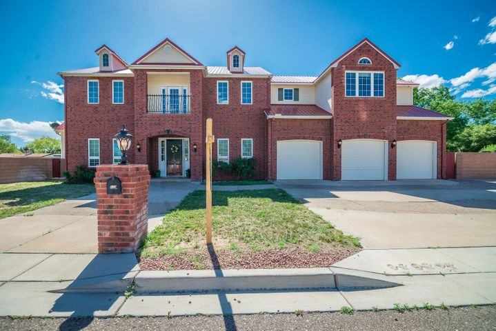 Wonderful custom brick home on 2 lots.  Features Theater Room with projector, speakers and all wired through attic.  Study,  Family Room, Living Room.  Kitchen features double convection oven, refrigerator, gas cooktop, instant hot water, and walk-in pantry. Master Suite with his & her closets, luxurious bath with jet tub, 2 sinks, make-up area, wrap-around shower with 2 heads.   All metal roof is 3-years old.  3-car oversize garage.