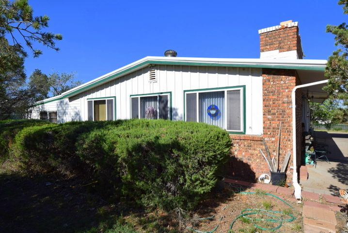 Great 3 bedroom home in Rio Communities. Great potential. Priced to reflect updates needed. 2 living areas, RV parking with separate gate, storage garage, 2 storage sheds, 2 car garage with a workshop, built-in sprinklers water a fully landscaped yard with beautiful trees, owned solar panels not in use.