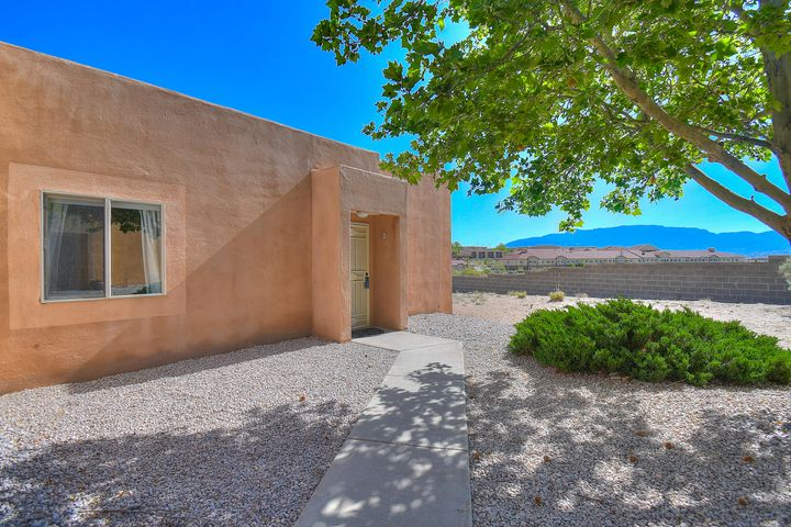 Immaculately well maintained condo with upgrades in a great! This cozy condo features new windows, new tile, and new roof. This single story condo offers  privacy, views of the Sandia Mountains and a fenced in back patio. Move in ready! Make it yours today!