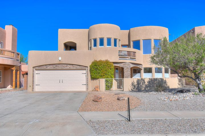Gorgeous two story custom home in the peaceful neighborhood of Trinity Estates with breathtaking views throughout. Located perfectly right at the edge of Rio Rancho connecting to Albuquerque and over looking Corrales. Wake up to mountain view's and end your day to city lights. Walk up to an enclosed gated courtyard to front entry to be immediately greeted by captivating windows, large chandelier and two story variance fireplace. The kitchen is perfect for entertaining. Includes stainless steel appliances, granite countertops, ample counter space, an island, elevated bar, breakfast nook, walk in pantry and a spacious desk area with plenty of cabinet storage. There are beautiful chandeliers, glass pendulums and recessed lighting on both levels. This home not only has radiant heat downstairs