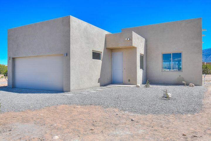 Make this house your home! New construction in brand new neighborhood in Placitas. Open kitchen with granite topped island. Great room has a cozy gas fireplace which opens onto a large covered patio. Beautiful views of the Sandias at every turn.