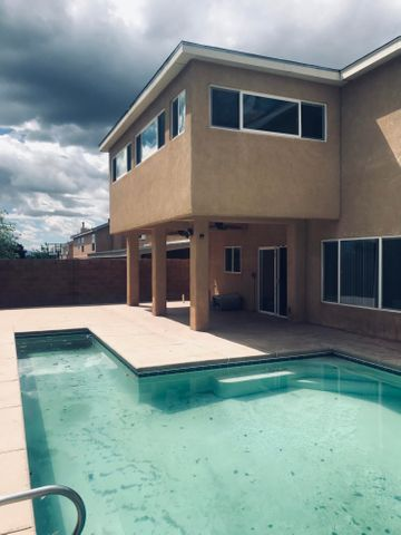 This is the only home currently for sale in this PULTE subdivision with an inground pool.  This is also the largest model at 3754 sf. Owners added an approx 300sf enclosed sunroom/den/pingpong-billard room off of upstairs master - not included in total SF. Views of the Rio Grande river valley & Mts are astounding from this room. All 4 bedrooms are upstairs with a jack and jill bath connecting 2 of them. The loft area has wine storage rack with wetbar and a spot for a little refrigerator. Downstairs is mostly tile, except for the office/den area which is carpeted.  Large family room with a gas fireplace makes the kitchen area appear huge. Home has been preinspected and repairs and painting all completed. Rpt availaible. Gunite pool takes up much of the backyard, along with covered patio.