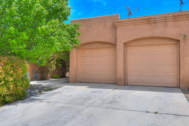 Delightful Townhome, A rare find for this area, 13 year new construction townhome that includes a two car garage on a larger cul-de-sac lot just off of Tramway.No HOA Fees In The NE Heights. Cul-de-Sac, Refrigerated Air, Walk in Closet, Tub and Separate Shower In The Master, Easy Care Landscape, Open Floorplan, Lots Of Natural Light. Corinthian Construction Project a Great Townhome With Easy Access To Kirtland, Malls And Freeways. Some City and Mountain Views.