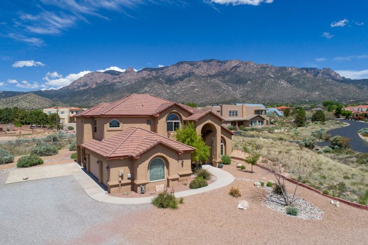 Fabulous Home nestled in an idyllic, peaceful, gated community. Positioned to take advantage of exceptional mountain and city views! Open, light filled spaces capture you the minute you walk in this home!! This well thought out Lee Michael  Multi-generational home can accommodate everyone!! The details and quality are evident! This home you must see!!