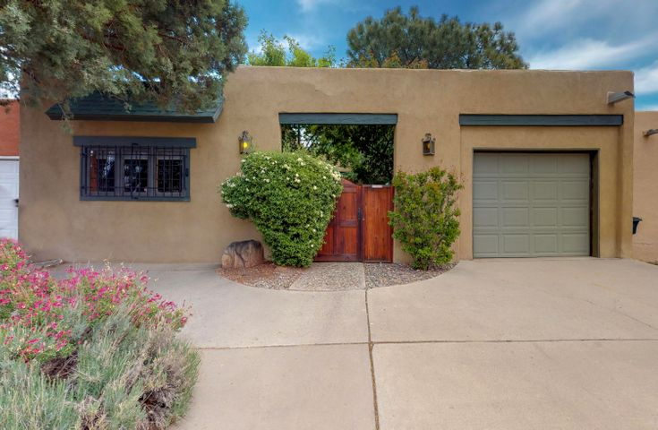 Peaceful, secure, well maintained contemporary patio home in the heart of the NE Heights. Enjoy 2 private courtyards, lush landscape, water feature & custom entry doors. Very private front courtyard & access to the backyard from living area & master bedroom!  2 Fireplaces, skylights & solar tubes adorn this casual, functional, single level floor plan. Large great room complete w/ log burning Kiva fireplace & engineered wood flooring.  Formal dining area is perfect for entertaining.  AMPLE storage, built-ins & closets throughout. Spacious sunny kitchen w/ eat -in area, 18'' ceramic tile & all appliances included. New TPO Roof & New AC in 2014, newer stucco, refrigerated air & NO HOA! Private master w/ attached ensuite, several closets & recently updated bath. Plenty of off street...