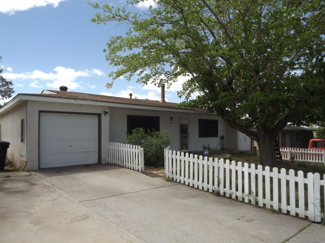 Ready to move into. Great 4 bedroom home in mature neighborhood in the Foothills of Albuquerque. Kitchen has breakfast bar that is open to dining area. Huge pantry to stock up all those bargains.  Home has a formal living room in addition to family room with French Doors that lead out to back yard.   Covered Patio, apple tree. Both Bathrooms are done in beautiful tile. Pellet Stove (save on utilities in the winter). Newer: roof (2015), lights, 6 Hunter fans, Renewal by Anderson windows, and new laminate flooring in living spaces.  ADT security, hardware owned. Large private Backyard.Close to Tramway, I40 and shopping.Home Inspection has been completed. Call for report.  Seller is painting the two turquoise walls in the living room and dining room.