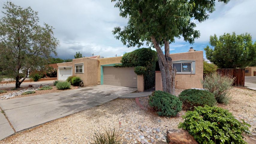 Great value in the Albuquerque Country Club area.  Rejuvenated Efficient Townhome has plenty of room to spread out and enjoy the ambiance of the area.  Home has very comfortable and spacious great room including living room, fireplace, dining area and kitchen. Kitchen has been remodeled and updated and is quite efficient in its layout.  The nice-sized master suite is next to the refurbished master bathroom; Bedroom Two is currently used as an exercise room/gym; (mini) Bedroom Three could be used as an office or craft room.  Private backyard completes this marvelous living opportunity.  NOTE: Sellers are making final 'TLC' touches in the house including paint, flooring and 'fine tuning'.