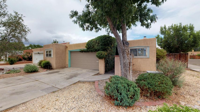 Rare Opportunity & Great Investment Value in the desirable Albuquerque Country Club area.  Rejuvenated Efficient Townhome has plenty of room to spread out and enjoy the ambiance of the area.  Home has very comfortable & spacious great room including living room (with fireplace) & dining area. Efficient Kitchen has been remodeled & updated with granite countertops. The nice-sized master suite is next to the refurbished master bathroom; Bedroom Two is currently used as an exercise room/gym; (mini)Bedroom Three could be used as an office or craft room.  Private backyard completes this marvelous living opportunity. Walking distance to restaurants & shopping. Could be Air B&B property or possible Home Office. Close to downtown, Botanical Gardens, The Zoo, El Vado Recreation area, TIngley Beach.