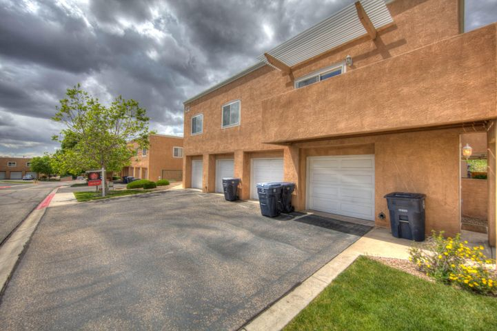 Beautiful 2 story condo in desirable gated NE Heights community, Close to CNM and public transportation. Enjoy this 2 bedroom 1.5 bath home with lots of light kitchen has a pass thru as to entertain your guests. Must see