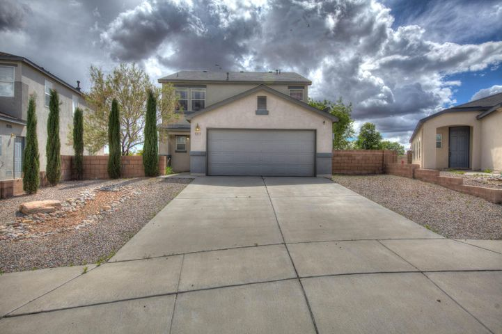 Great 4-5 bedroom home in Enchanted Hills of Rio Rancho. Enjoy this spacious home with large living room and extra room for office or 5th bedroom. Large family room with open kitchen. Up stairs enjoy 4 spacious bedrooms. Master is large with spa like bath and walk in closet. Huge yard fully landscaped. Make this a must see.