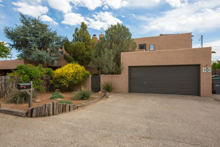 North Valley adobe home! So warm and charming.  Beautiful SW features include brick floors, vigas, tongue and groove ceilings, exposed adobe, and kiva style fireplace.  Updated kitchen and baths have stylish materials and finishes.  2nd story deck and lovely outdoor space.