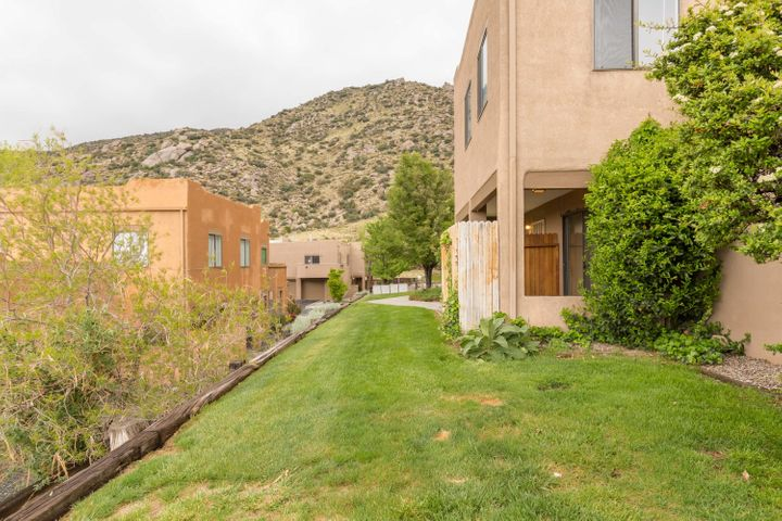NEW LISTING!  Fantastic Location, Condition AND Priced to sell!!   Located in the foothills in Abq's Sandia Mountains, 2900 Vista Del Rey NE Unit 18B is a convenient place to call home.  Step out to walk, run, hike or bike some of the best trails Abq offers!  Nestled in a sharp community with lush grounds and spectacular mountain and city views from every door and window, this two story end unit features 2 bedrooms, 3 bathrooms, gas log fireplace, roomy kitchen with island return, a single car garage with opener and an inviting private patio which lets the outdoors right in!  Plus...fridge, washer and dryer stay and seller paid inspections are underway! Don't miss!