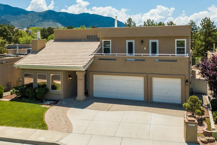 Wonderful opportunity to own a custom home in the highly desirable gated community of Tanoan. Enjoy the peace of mind that comes from living in a 24 hour guard gated community. This home features tons of updates including recent synthetic stucco, a recent TPO Roof, refrigerated air, upgraded windows, fresh paint throughout, and new carpet. Kitchen is light and bright, and features fresh white cabinetry, high end granite, updated tile flooring, and a breakfast nook overlooking the backyard. There are 2 large living areas, an elegant dining room, and flex room off master which could be a 5th bedroom, home office, nursery, exercise room etc. An oversized 3 car garage with insulated garage doors offers tons of storage. Enjoy the close proximity to the country club from this great home!