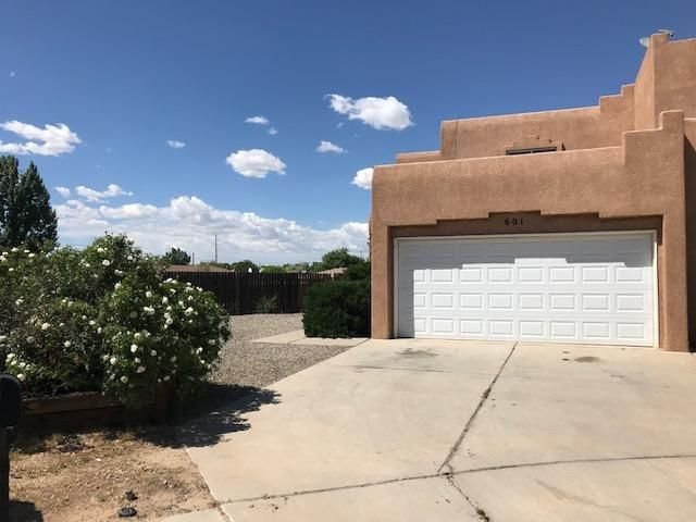 Great opportunity for a large affordably priced 4 bedroom, 3 bathroom home with 2 car attached garage!  You will forget this one is attached on one side because of the spacious pie shaped lot!  Nice space to plan your dream yard.  Easy and convenient location in Los Lunas and only 25 minutes drive to Albuquerque.  Also this one is close to the Rail Runner and transportation center in Los Lunas!  Includes a washer, dryer, and refrigerator and one bed and 3/4 bathroom are down stairs!