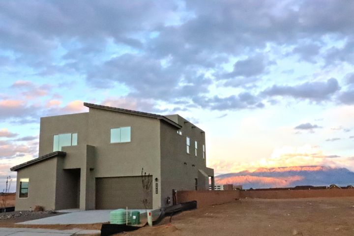 Welcome to the Enclave at Vista Montebella! This great new community is located just west of Rust Medical Center and close to all the new expansion and growth in Rio Rancho. This open living floor plan is beautifully appointed with our finest finishes. Quartz counter tops throughout, Bosch appliances and designer cabinetry. The downstairs features an huge kitchen with an island. The kitchen opens to the living and dining space and exits to a fantastic covered patio. Upstairs is a giant master suite with a walk in closet and a master bath complete with a vessel tub and walk in shower. @ upstairs bathrooms open to a loft/second living space. This house is just completed and ready to move in to!