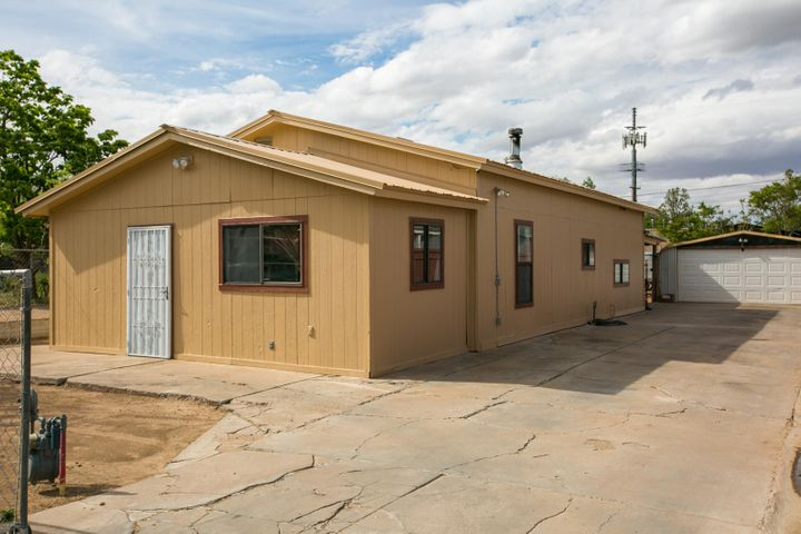 This Casita is located in the North Valley and is in one of the most convenient locations in town.  The yard is all fenced in and it features a Detached Garage with electrical and automatic opener so there is enough room for your toys! Also there are flood lights all around the home and set up for a security system. The home has an country kitchen and  a cozy fireplace to keep you warm.  New metal roof at the beginning of 2019 and a new front door to welcome you home. All appliances will stay including the washer and dryer.