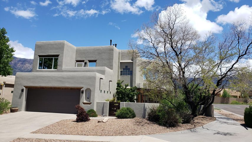 Beautiful Pueblo style home located in the gorgeous High Desert, Desert Sky community. Spectacular views of the Sandia Mountains and breathtaking views overlooking the city.  This spacious, two story home boasts an awesome great room with fantastic mountain views. Large loft/game room could be second living area. Bonus in-law quarters / mini master with a full bath downstairs. Upstairs the master bedroom offers a small sitting area and views. Plenty of storage space throughout the house and garage. Great yard front and back, perfect for entertaining. Hit the walking trails or take the dogs to the park, all right here. Show and sell!