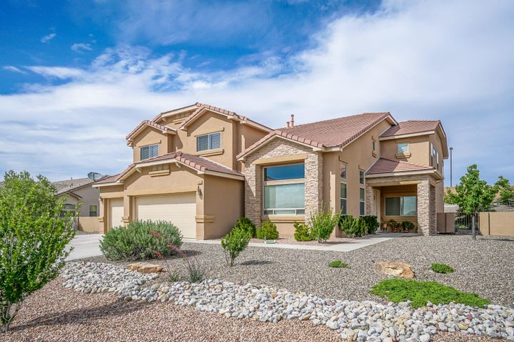 Gorgeous MOVE IN READY two-story home in the heart of NE Rio Rancho. This pristine 5 bedroom, 3 full bathroom home with enormous loft won't last long! Open concept kitchen with large eat-in center island, stainless steel appliances, granite countertops and soaring ceilings make this great for family gatherings. This superb lot comes with a spacious landscaped backyard with basketball court and incredible views- perfect for entertaining or anyone with pets. Quick access to schools, shopping, and great dining.  Don't miss out on this amazing opportunity, this house will NOT last long! Schedule your private showing today!!