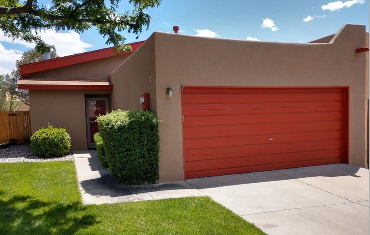 Charming 2bdrm, 2ba, 2 car attached garage with fireplace.  Recent new stucco and flooring.Sweet little backyard with 14X12 covered patio.Land is leased. 20 year mortgage land lease is $286 monthly, 30 year mtg land lease is approx $306