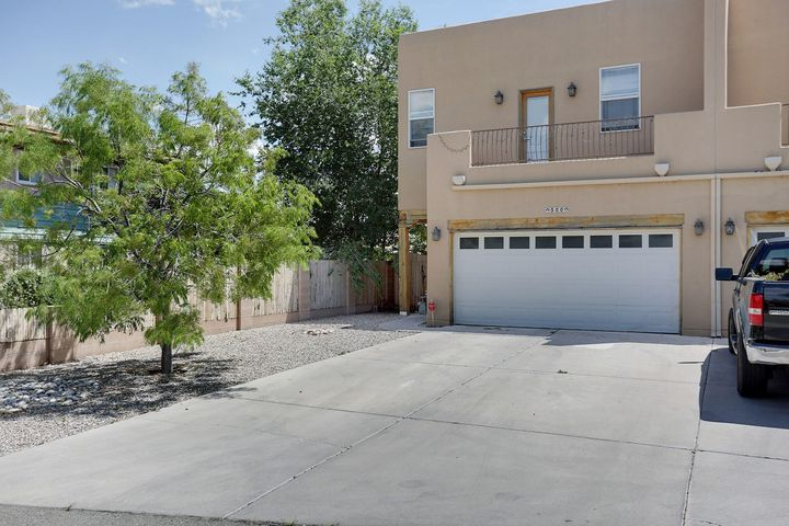 Over look the heart of Albuquerque in this gorgeous home! Wooden floor downstairs that blends perfectly with a warm open living space and kitchen with quality Hi-Mac counter tops and upgraded cabinetry. Carpeted upstairs with laundry room, 3 bedrooms and 2 baths upstairs with over sized closet for the master and one bathroom downstairs. With amazing city views in every room and the sound of the zoo close by, this home will not be available for long!