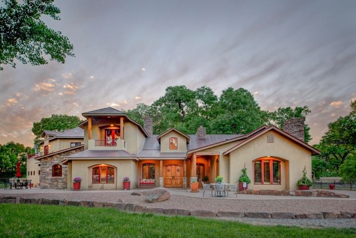 The 5400+sqft, home is located on 3 acres at the Bosque. A peaceful and private property, tucked back off of 4th, minutes  to  I-25, & 35 minutes to Santa Fe.  Such a nice home you may never want to leave; perfect for entertaining family, friends, fund raisers, balloon fiesta & horses. First floor master suite, with fireplace & outside access. Giant windows  throughout bring the outside in.  PROPERTY IS ON CITY WATER & SEWER, BUT, has a private well and declared water rights too. Superior quality, well thought out custom home, with superb attention to detail., and outstanding craftsmanship.  Mesquite hardwood flooring, flagstone accents, wolfe appliances, mudroom, antique wood beams, over sized 3 car garage with work area & tons of storage. Staircase to family room from garage.  See ''MOR