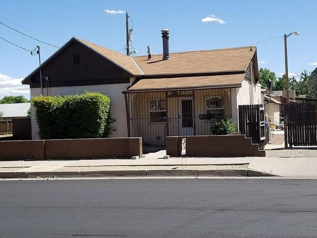 WOW! Check out this amazing rental property or great in law quarters property!!  This unique Adobe home is only 2 blocks from the Museum & Old Town! 2 Complete Homes Are Attached Yet Private. The huge fenced In Yard With Large Storage Shed.  Hot Tub Is stays. This spacious property is a combined four city lots and has two attached homes separated with a locking door (Zestimate only reflects one lot). The homes sit on two of the tax lots.  Property has an outdoor hot tub. This property has a huge yard complete with covered patio area and covered parking.