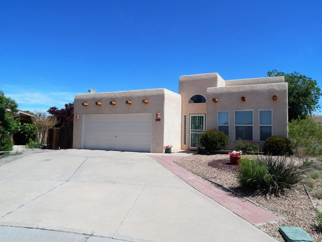 Lovely home on a quiet cul-de-sac!  Great floor plan with vaulted ceilings and a bright and open feel.  Living Room has a custom kiva fireplace. Master Suite with a Jacuzzi tub to relax and refresh.  Refrigerated air conditioning will keep you cool all summer.  Backyard is perfect for outdoor entertaining or just relaxing.  Golf course living makes this home a great choice!