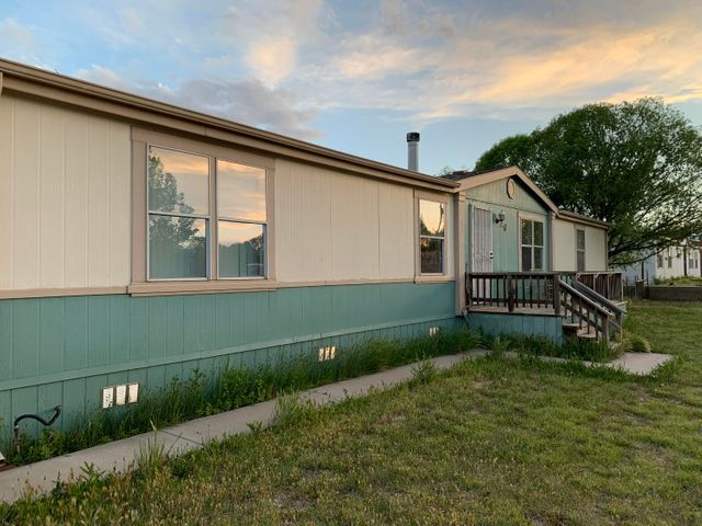 Home sits on half an acre with mature landscaping.  Open floorplan with 3 bedrooms and 2 baths.  Large Kitchen for the chef with island. Back patio to sit and enjoy the sunsets with a fenced back yard that is dog proof.  Plenty of room for your toys or RV with back yard access.  Wood burning fireplace to stay cozy on those cold nights.  New Roof installed in Aug. 2018.  Storage shed in back for all the tools.  Home comes mostly furnished including refrigerater, chest freezer, beds and dining table and some dishes and pots and pans.