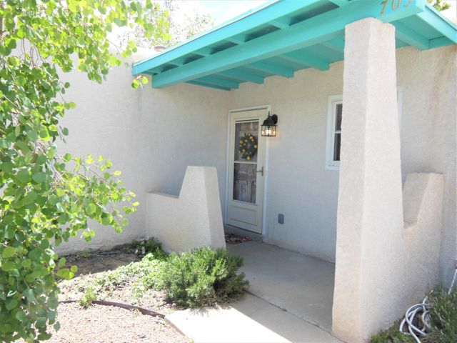 Great starter home with a double garage plus carport for high profile vehicle or small RV. Landscape maintenance will be done in a few days and the back yard was professionally landscaped and is amazing with covered patio nectarine, locust, nm olive and other trees and plants.The inside has lot of fresh paint. newer furnace and refrigerated air. double pane windows. Fresh carpet and shiny tile. Exterior stucco and paint look really great. Storm door and really pretty entry door.
