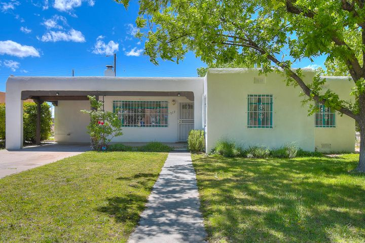 Bring your pickiest buyers to this Remolded beauty, New Stucco, water heater, furnace, LG units in master room & bath, Fridge and cabinets.  Also the SOLAR IS FULLY OWNED AND PAID OFF.  Close to UNM Hospital, UNM Law School and Jefferson Middle School.  Also set up to collect water.