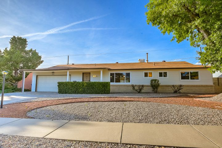 Light & Bright home in this established NE heights neighborhood is in the Sandia School District. Newly renovated 3 bdrm, 2 car garage, w/ office/poss. 4th bdrm, 2 baths, large hobby/mudroom (not included in total heated space) & separate laundry room, + a closed in Sun-room (217 additional sq. ft. of living space) w/ a gas log fireplace on a thermostat. Water heater, furnace, A/C unit, double pane windows, & 200 amp electrical service, all installed within last 5-7 yrs. Current updates include: New paint & laminate wood flooring throughout, new carpet in bedrooms, kitchen counters & back splash w/ new stove, master bath completely redone, new hardware & light fixtures. Large, very clean well maintained lot. Landscaped, w/ fantastic curb appeal. Close to stores & restaurants. Welcome Home!