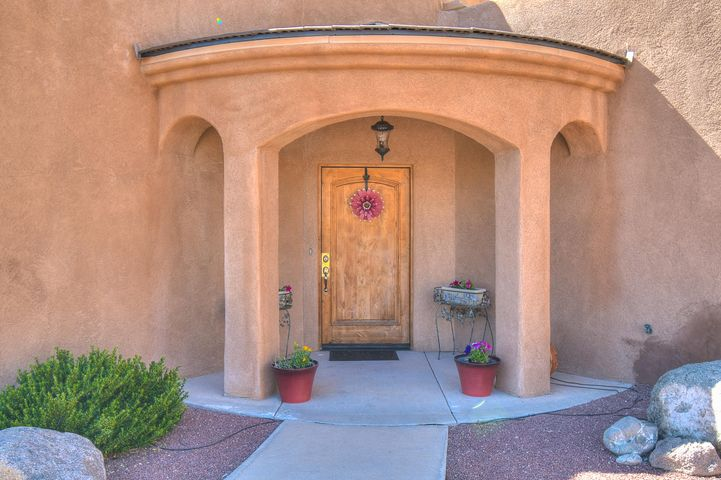 This 3400 SqFt home sits on a peaceful Cul du Sac in one of Albuquerque's most desired locations! Enter into a large open living area that leads to a beautiful kitchen with plenty of space for the entire family to gather.  Downstairs there is another large living area that would be perfect for movie night or even overnight guests!  The upstairs Master Suite is an oasis all its own  There is a large sitting area and a spacious master bedroom. Off of this area is a private balcony perfect for watching Albuquerques beautiful sunsets!  If this isn't enough to pique your interests, the yard will allow you even more privacy and entertaining space. Cap all this off with a large 3 car garage and there isn't a more perfect home in the city for you and yours.  Plan to see this one today!