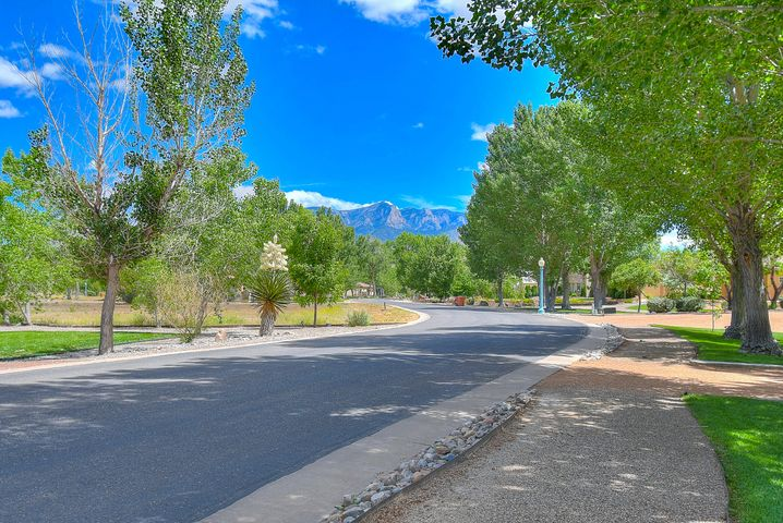 Lovely Green Acre situated in the Elegant Gated Community of Bosque Encantada. Neighboring to the Rio Grande, Bosque Encantado features Million dollar homes, grassy lawns, a plethora of mature Cottonwood trees, trail access to the River from within the neighborhood, and amazing Sandia Mountain views. Such an outstanding opportunity to build your dream home!  Convenient to the Rail Runner Train, Championship Golf Courses, Shopping, and I-25 for a convenient commute to Albuquerque AND Santa Fe. Owner Financing  Available -  20% down. 6% Interest, 30 year amortization, 2 year call. All offers considered.