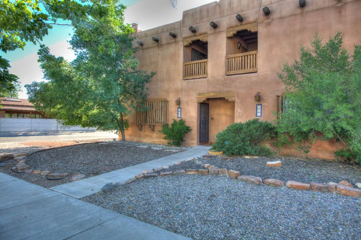 Live and work zoned C-1Enjoy Santa Fe style and Albuquerque affordability in this charming, cozy Hap Crawford town home! Stylish updated baths & lighting, polished brick floors, kiva fireplace, high beamed ceilings with ceiling fans, large private rear courtyard & shaded front balcony, covered & open off-street parking. Energy-efficient quality construction with tons of built-in storage. Great Downtown neighborhood provides convenient location for attorney, therapist, architect, designer or graduate student. No HOA. You will not want to miss this one.