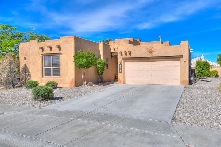 Simply gorgeous, single level contemporary Santa Fe style home on supersized lot! Light, bright & open floor plan features a large great room with corner fireplace, open to the dining room & kitchen w/sunny breakfast nook & walk-in pantry. Spacious office/exercise/bonus room could be enclosed for 4th bedroom. Master suite w/luxurious tub & separate shower & walk-in closet. Near schools, shopping, restaurants!