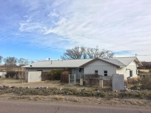 Enchanted country living. This 2700+ sqft, renovated ranch style adobe home on approximately 3.2 acres boasts 3BR/2BA with separate inlaw quarters/apt - PLUS a 2BR manufactured home - that's 3 dwellings! Live in one and rent the other two or rent all three and travel the world! Situated just north of Socorro, this small hobby farm comes complete with mountain and Rio Grande bosque views, and horse stalls.  Of the total acreage, approximately 2.2 acres are laser leveled and irrigated pasture currently planted in grass hay. Don't miss this opportunity!