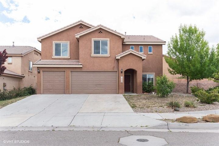 This  lovely spacious and light filled 4 bedroom, 2.5 bath home has a great layout with multiple living areas + a large loft. Open floor plan and an inviting kitchen with an island and pantry. The master suite upstairs features a soaking tub and separate shower. Recent updates include: tile and carpet throughout, paint, kitchen tile backsplash, bathroom tile counters/shower surrounds - this home really shines! Located on an almost quarter acre lot, there is plenty of room for relaxing and entertaining. Don't miss this one!