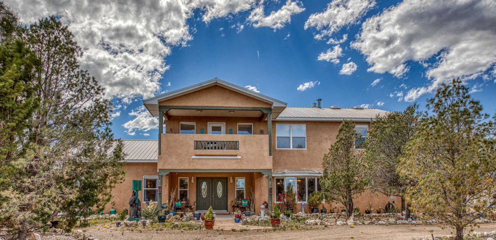 This Edgewood, NM home has 2970 sf of heated space and 3395 sf under roof. The home sits on 2.25 acres and is located just 30 minutes from Albuquerque making this an easy commute to the city via the I40 corridor.  Santa Fe is about an hour's drive for awesome food, fun, culture and art. The home is 3 bedrooms with a study that could easily serve as a 4th bedroom. The master suite is spacious with a large walk-in closet. Bedrooms 2 and 3 are upstairs separated by a Jack & Jill bath.  The upstairs loft could be used as office space or a second living area. The balcony offers a lovely view of the Estancia Valley. The kitchen features top-of-the-line appliances, island, eating bar and walk-in pantry. The backyard is built for